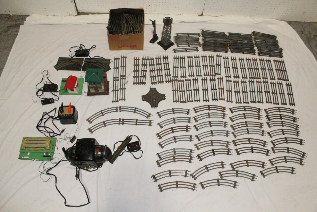 Large set of Lionel train tracks and accessories