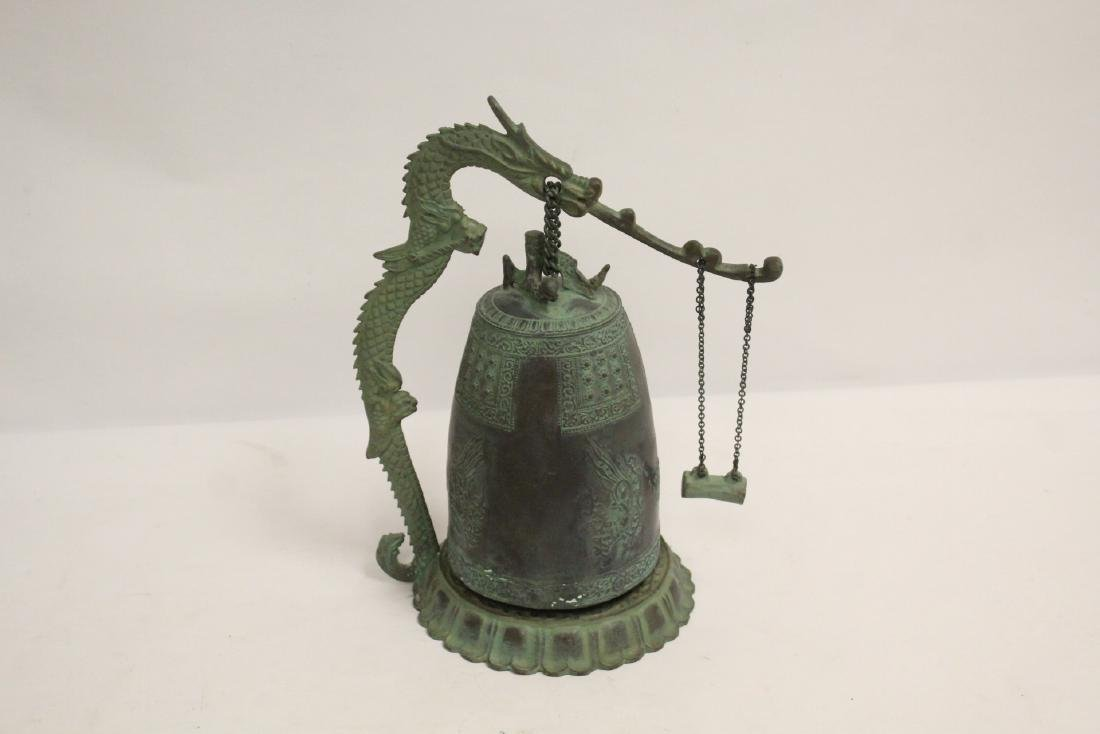 A bronze bell and a bronze wine server - 3