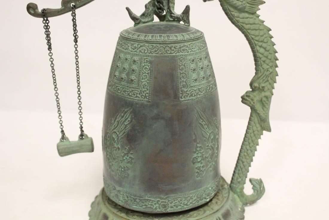 A bronze bell and a bronze wine server - 6