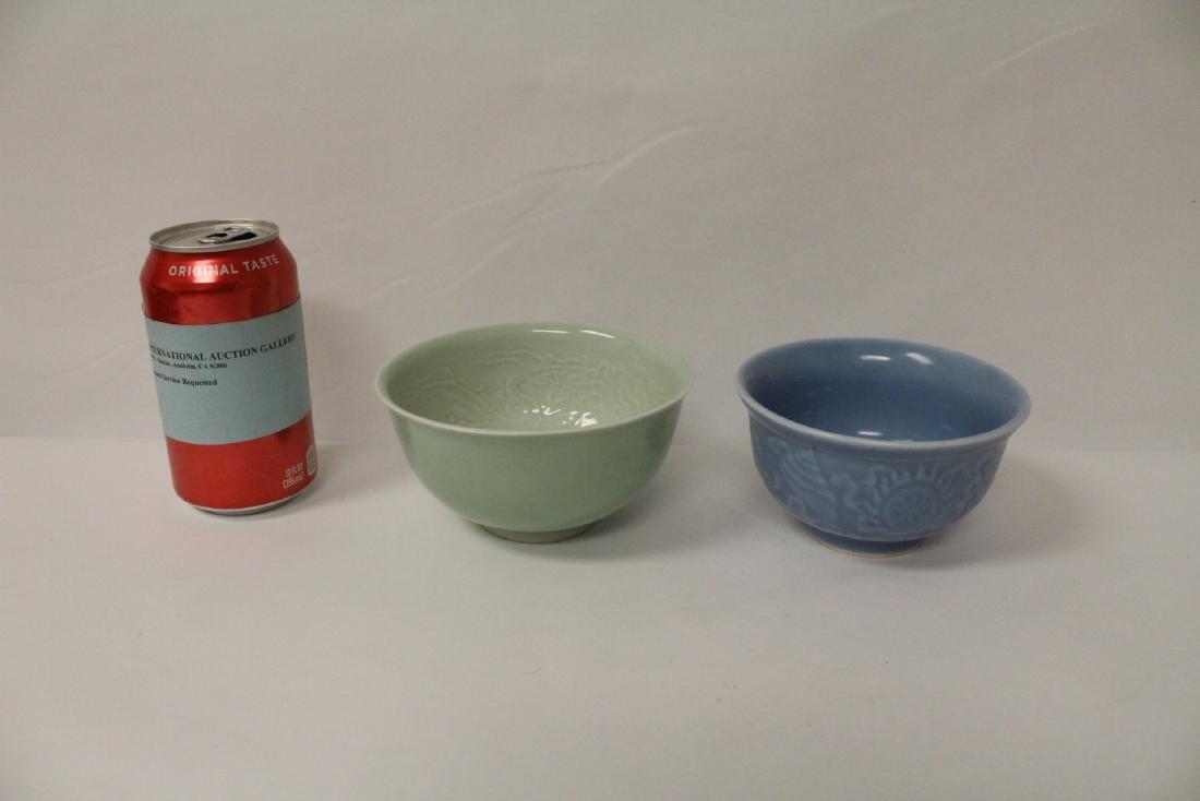 A blue glazed bowl, and a green glazed bowl