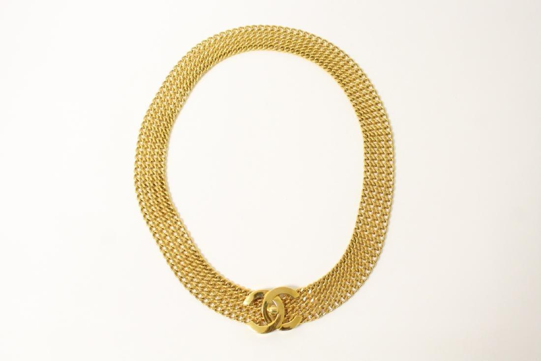 A gilt metal genuine Chanel belt
