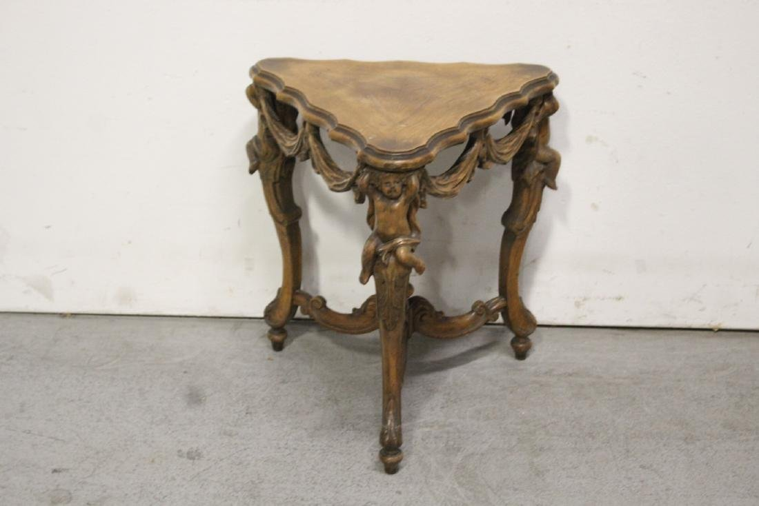 A beautiful Italian walnut triangular table