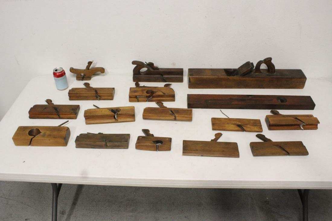Lot of antique woodworking planes, tools