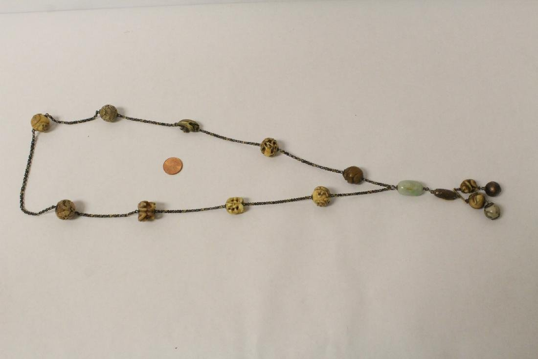 Japanese antique necklace with ojime beads, signed