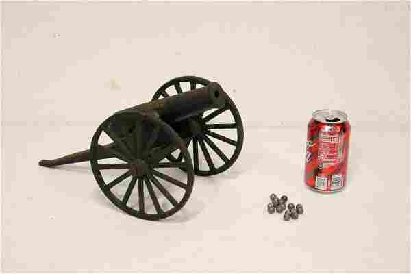 Victorian cast iron toy cannon with lead cannon balls