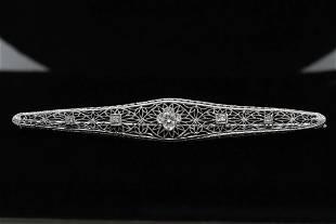 Beautiful 14K filigree design diamond brooch