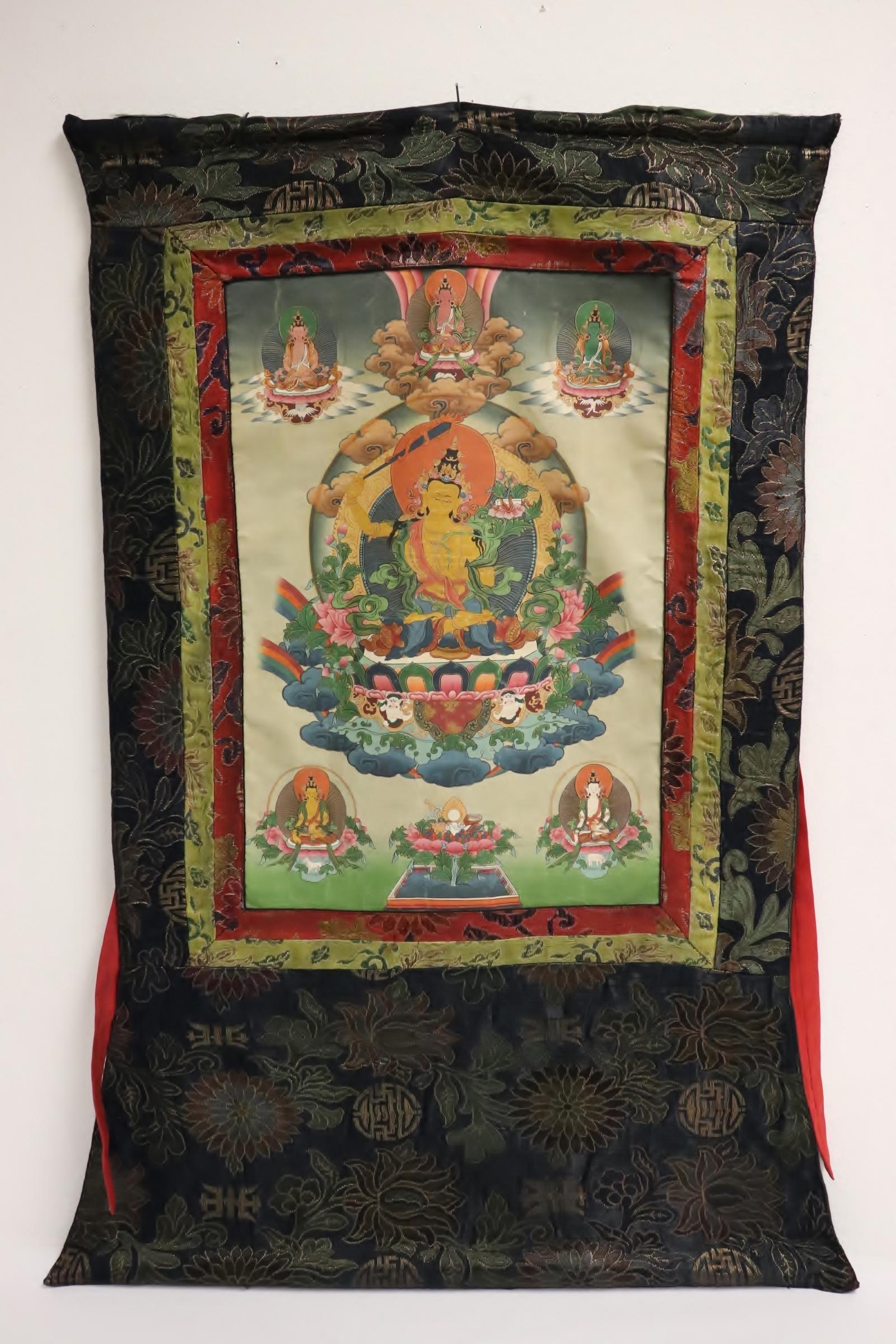 A Tibetan hand painted thangka