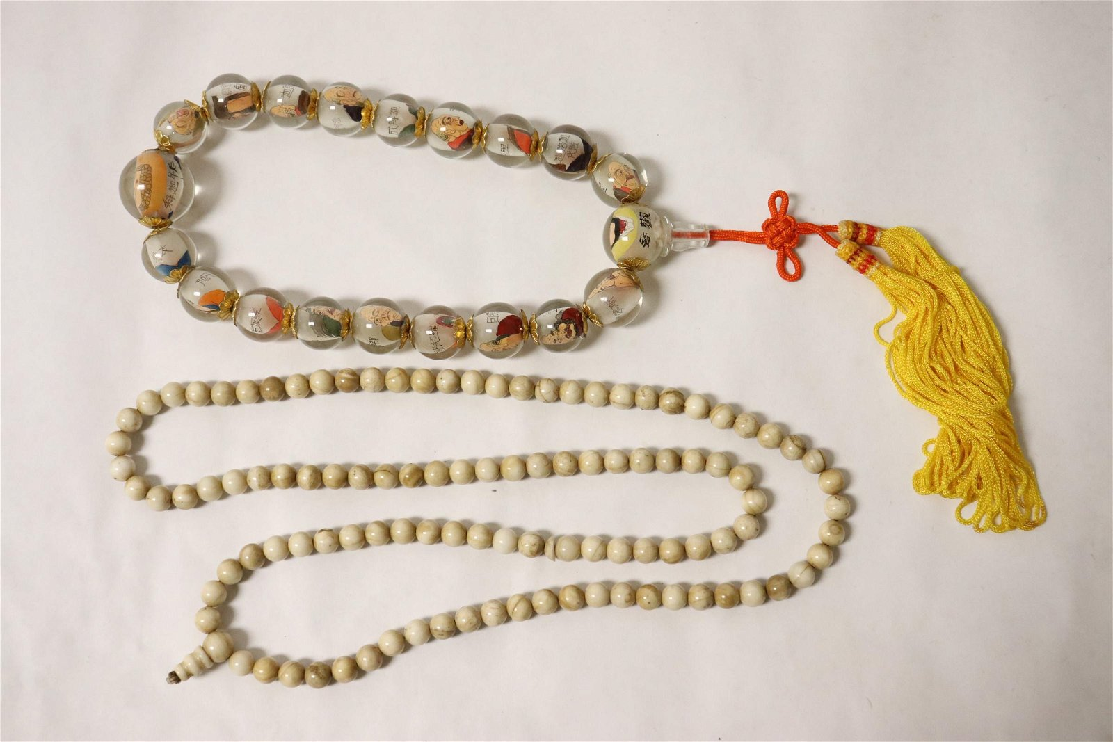 A jade like necklace, & a inside painted bead necklace
