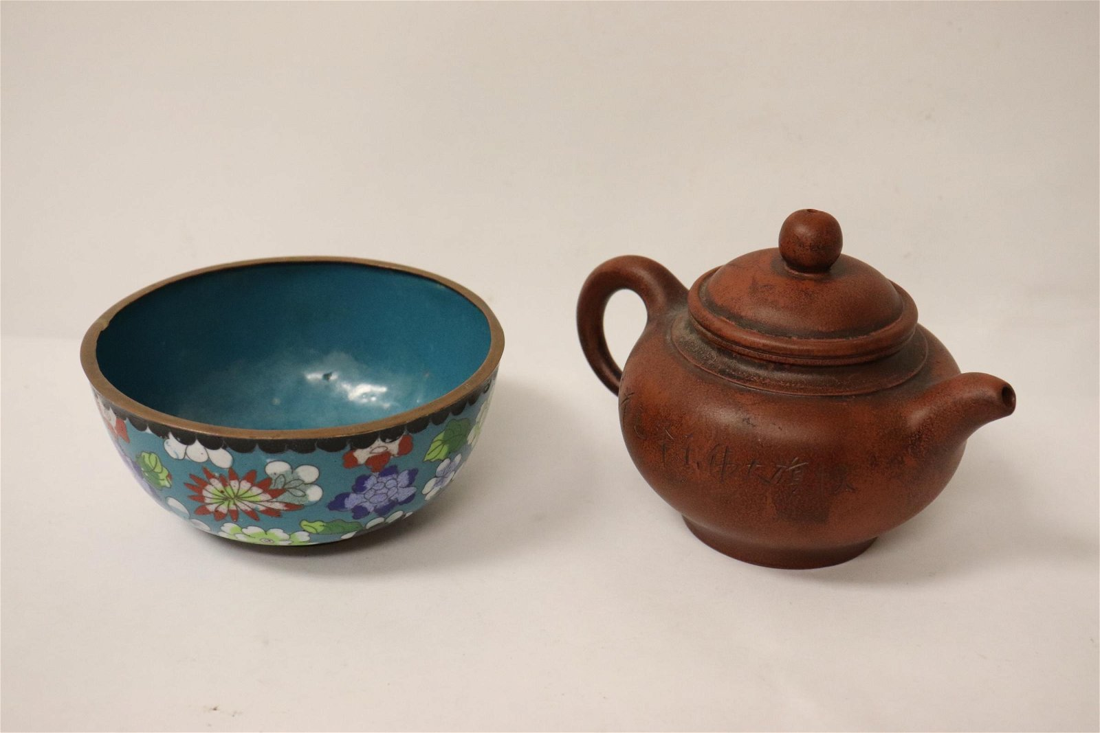 Chinese Yixing teapot and a cloisonne bowl
