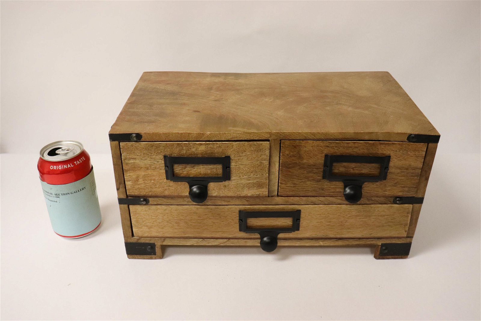 A teak wood miniature chest