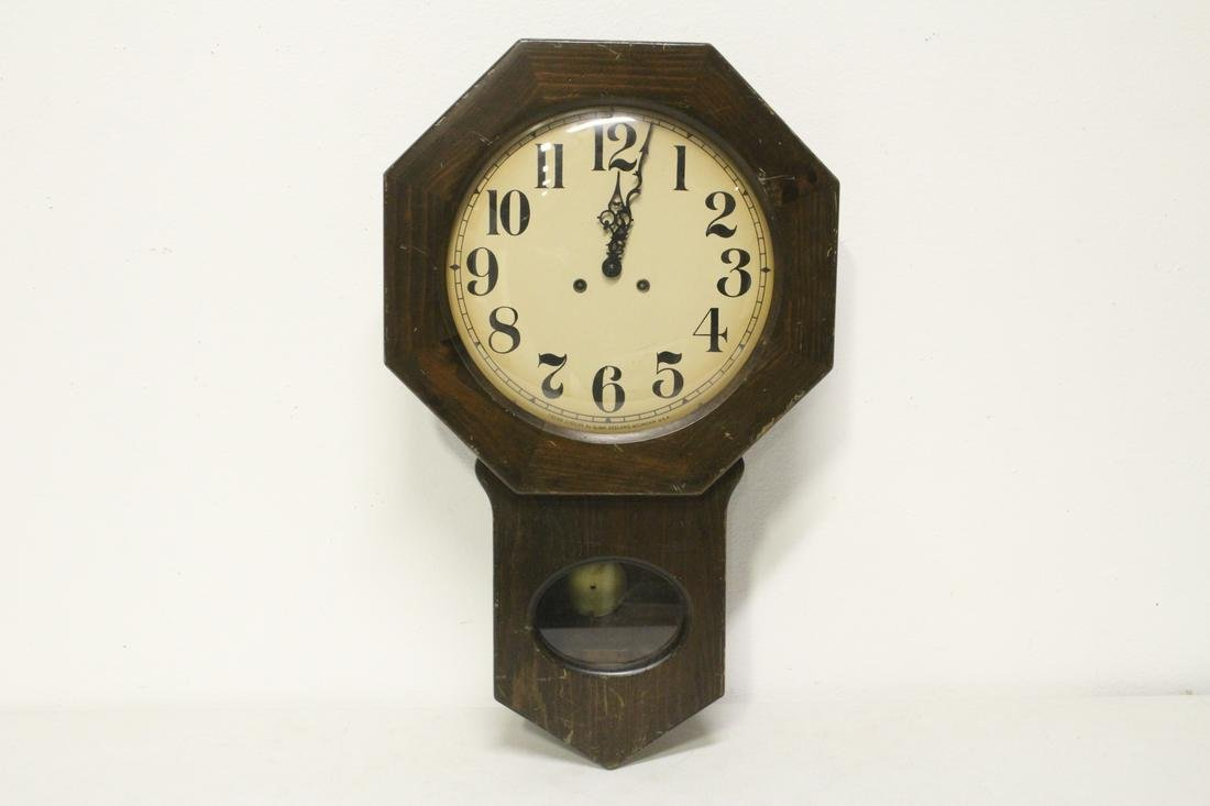 A key-wind wall clock