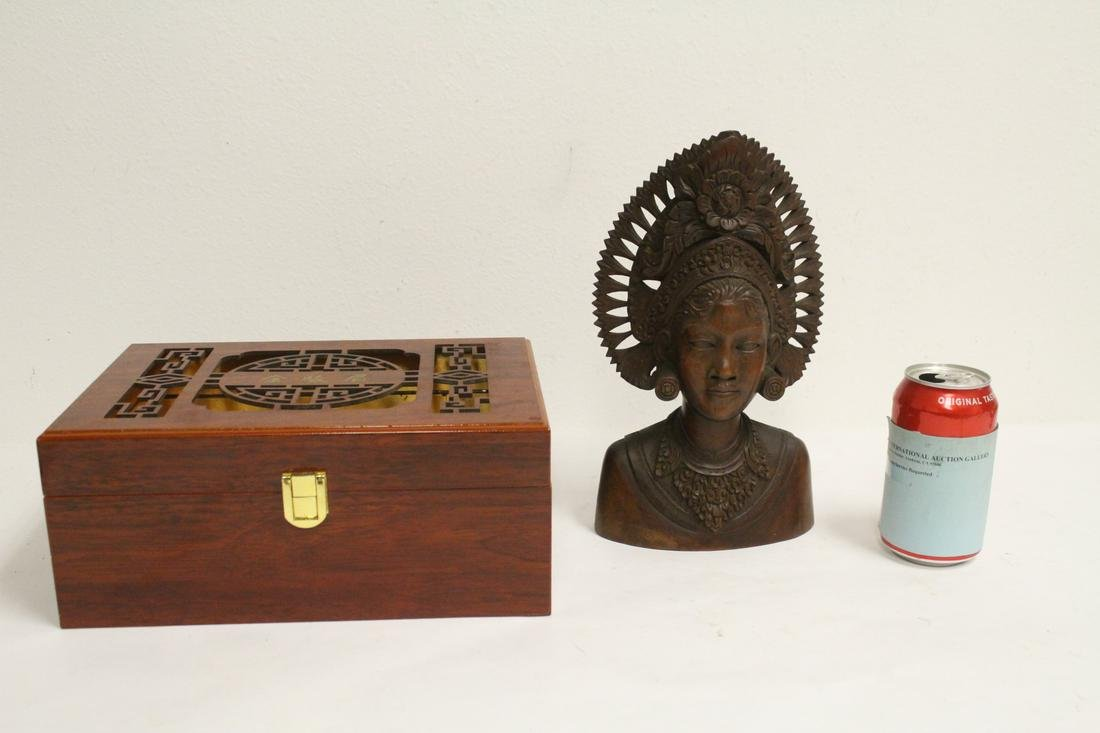 An iron wood carving and a Chinese box