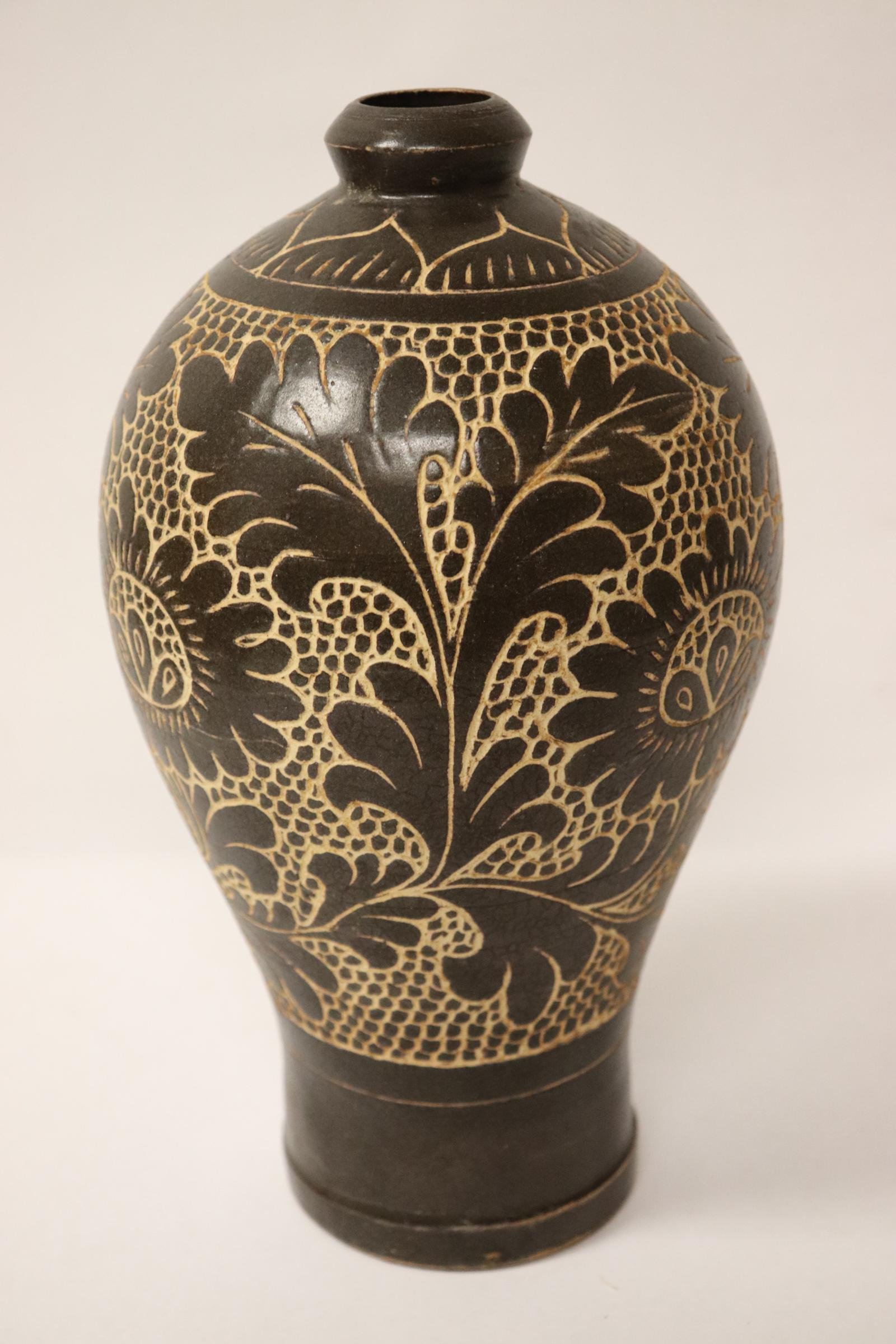 A brown glazed and carved Song style meiping