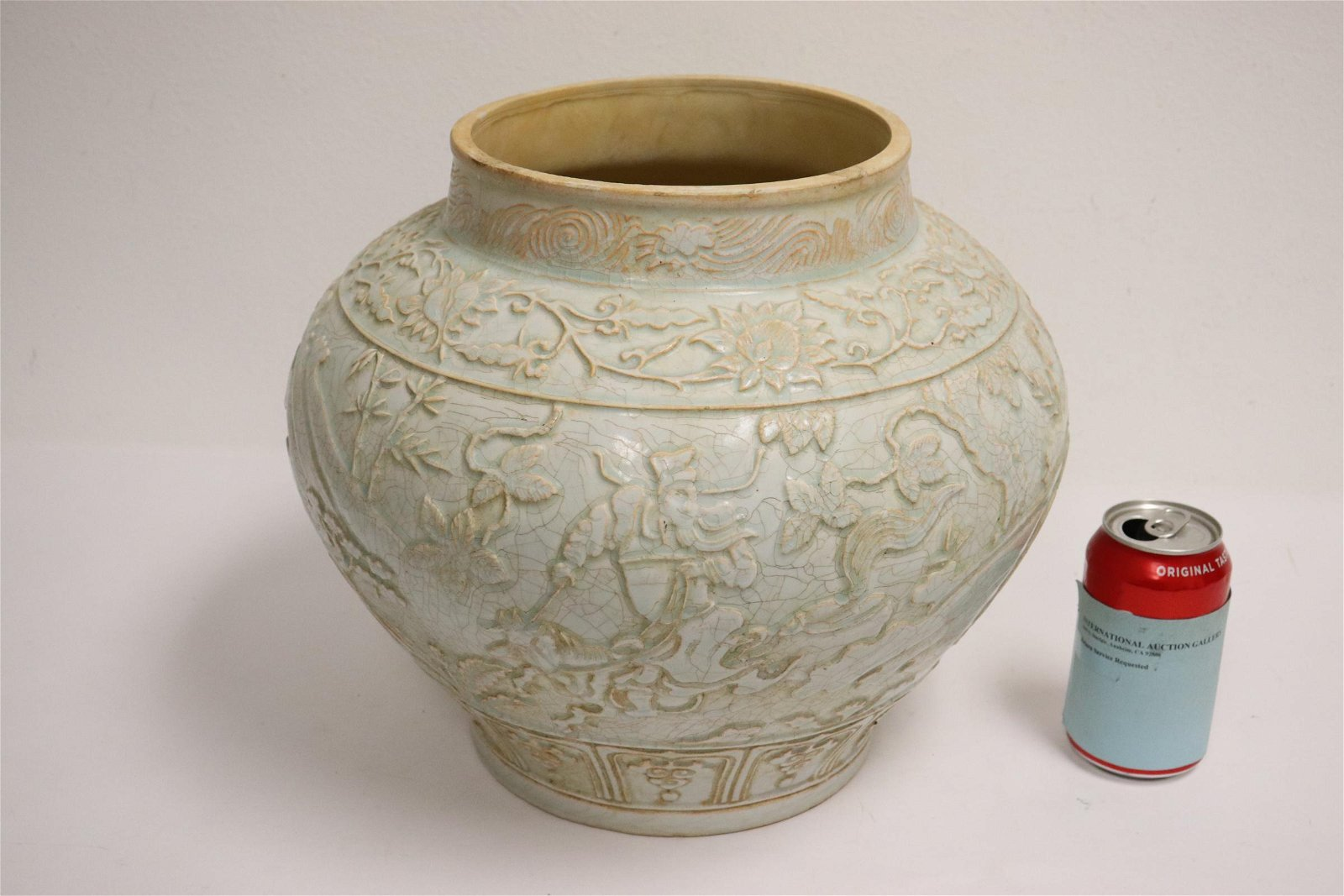 A large celadon porcelain jar