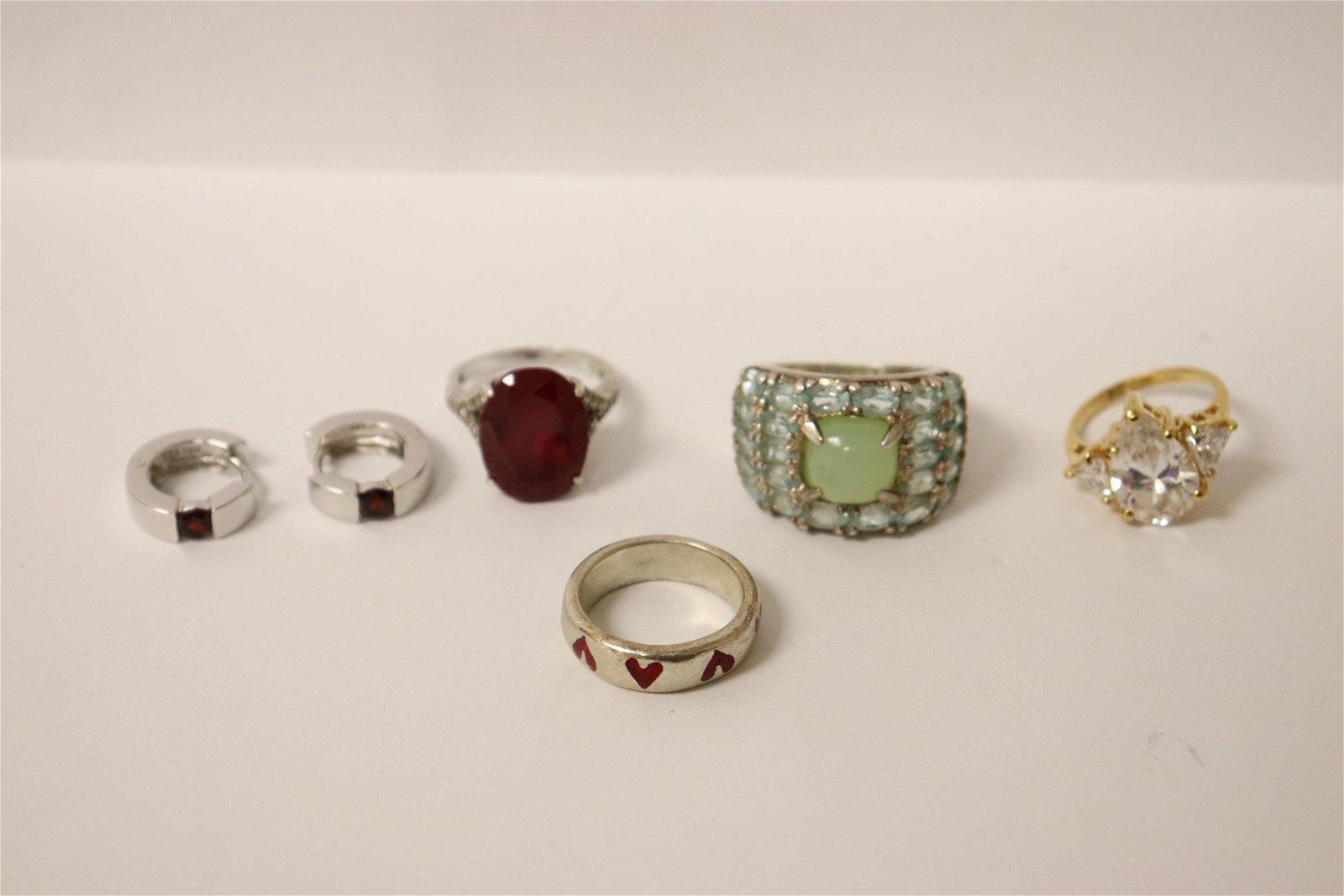 4 sterling rings and pair sterling earrings