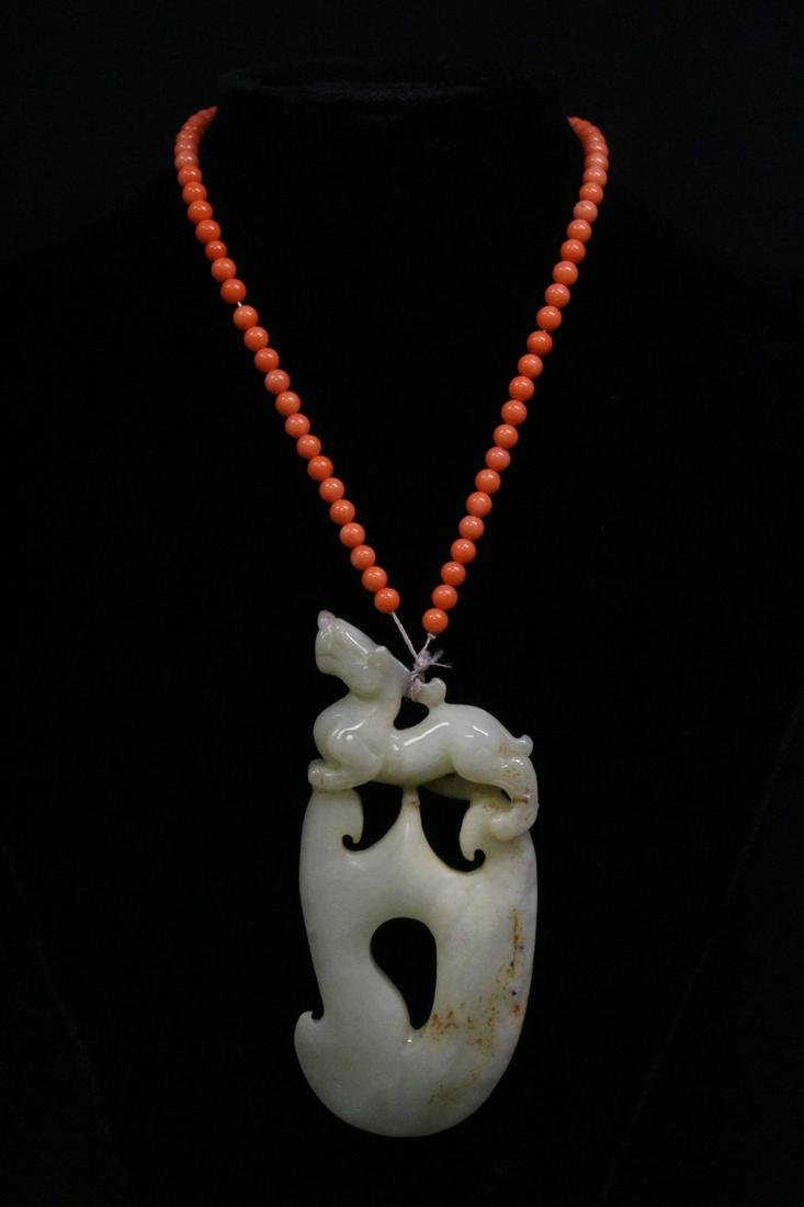 Large white jade carved ornament with a necklace