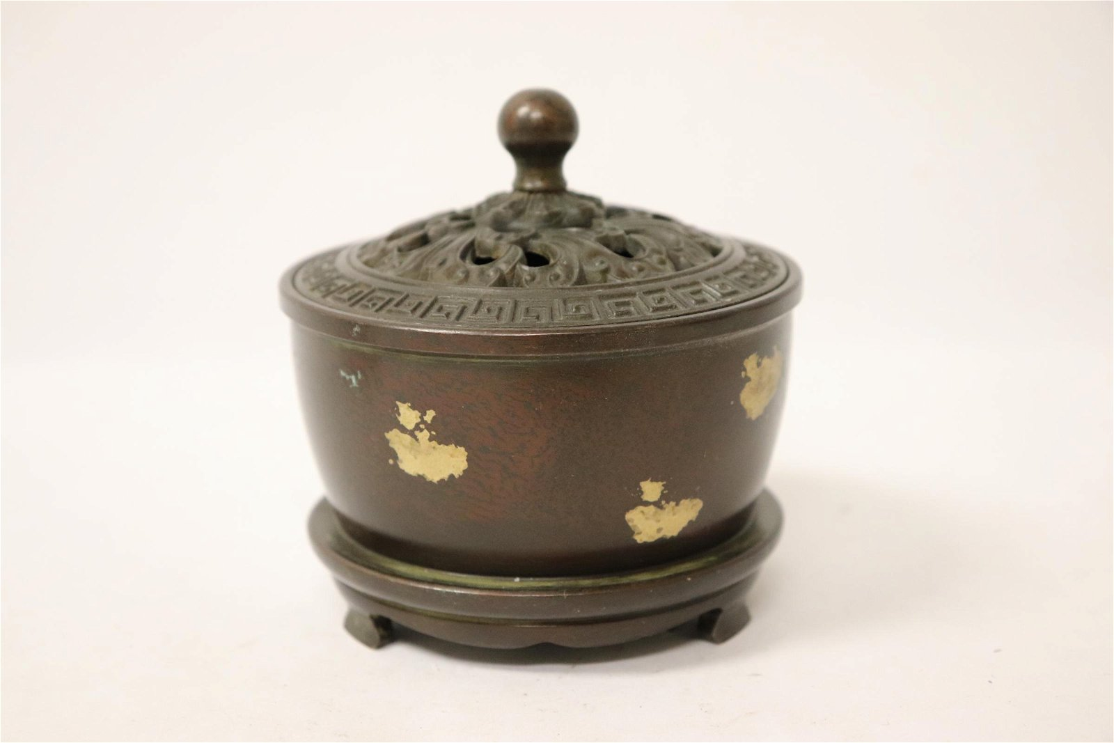 A heavy Chinese bronze covered censer