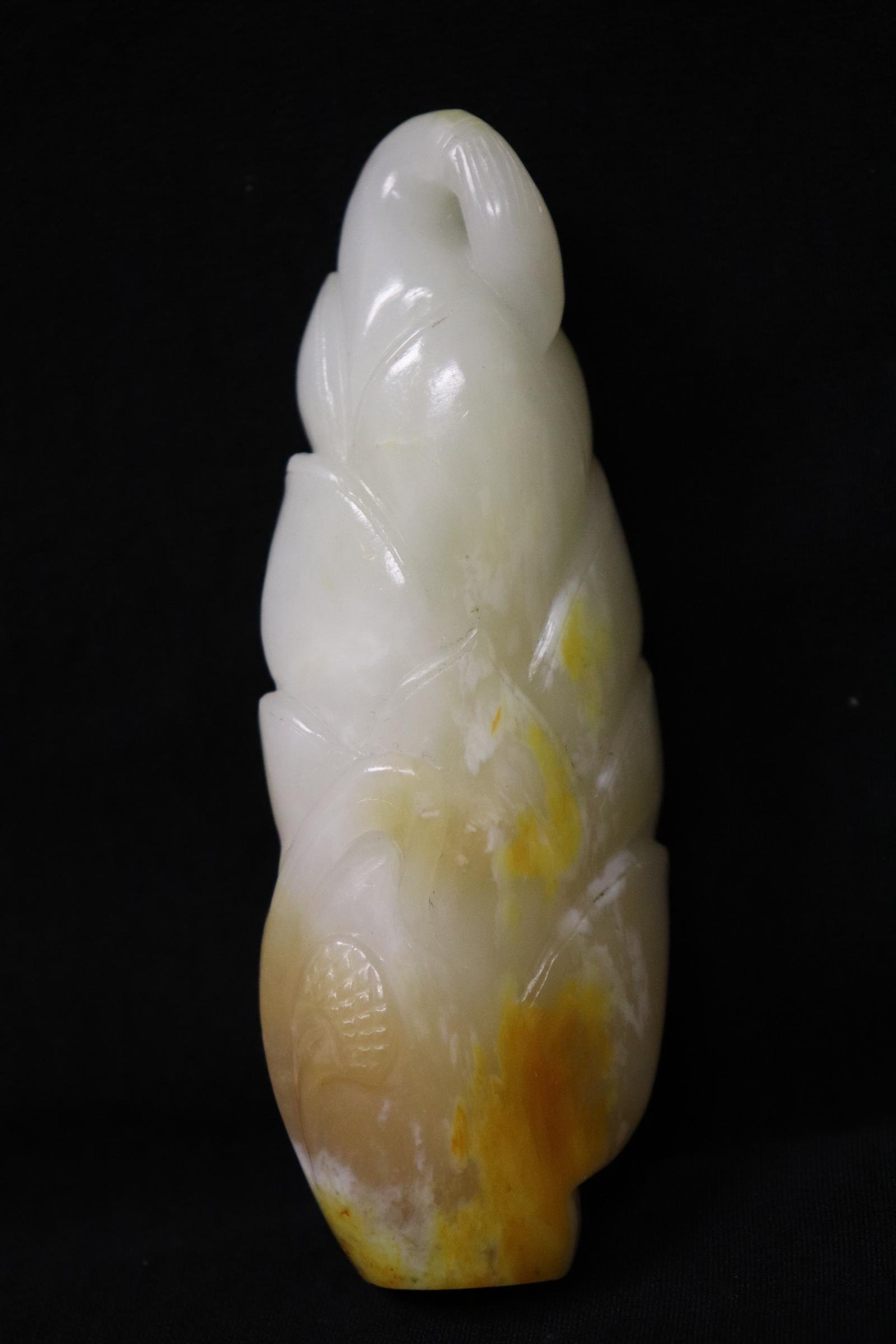 A white jade carved ornament