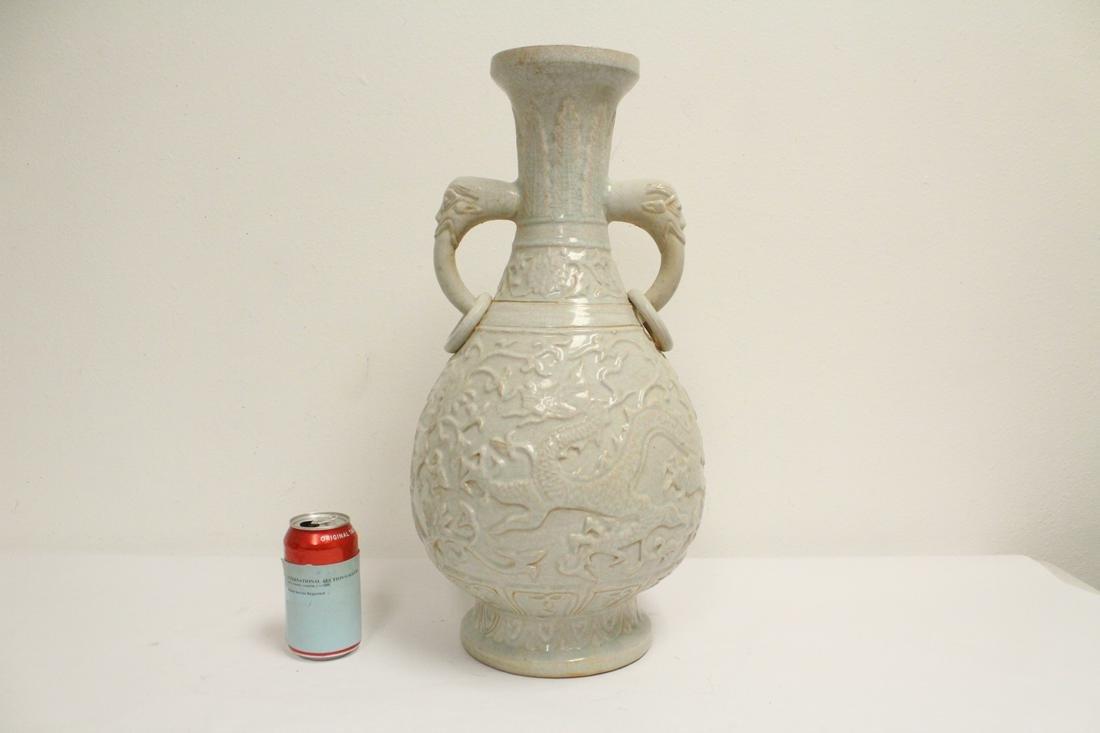 A large Chinese celadon vase with elephant motif handle