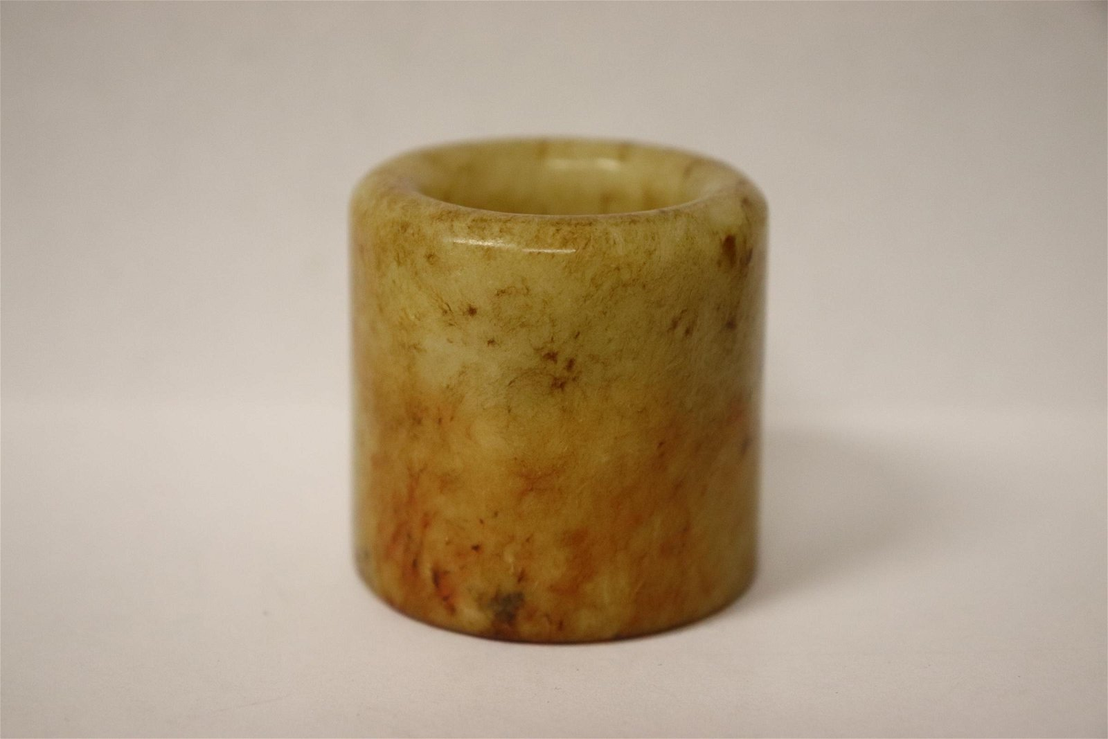 A white jade carved archer's ring