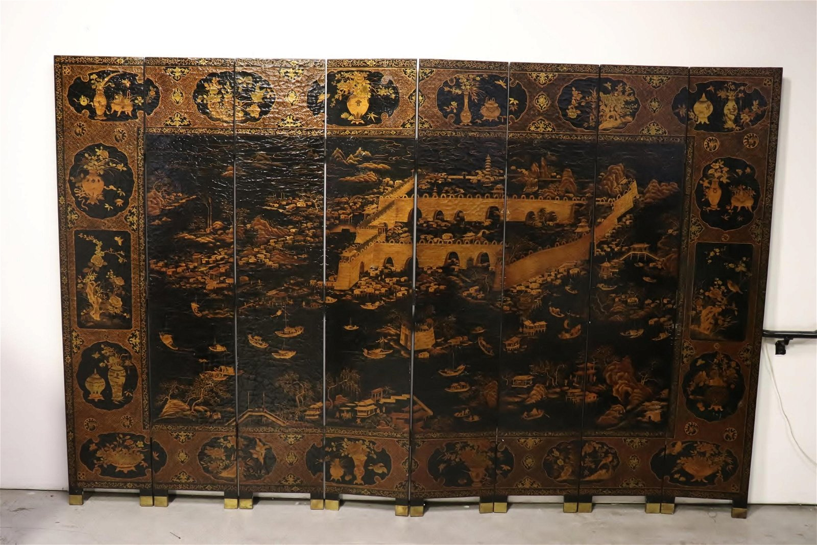 A large Chinese 8-panel coromandel room divider