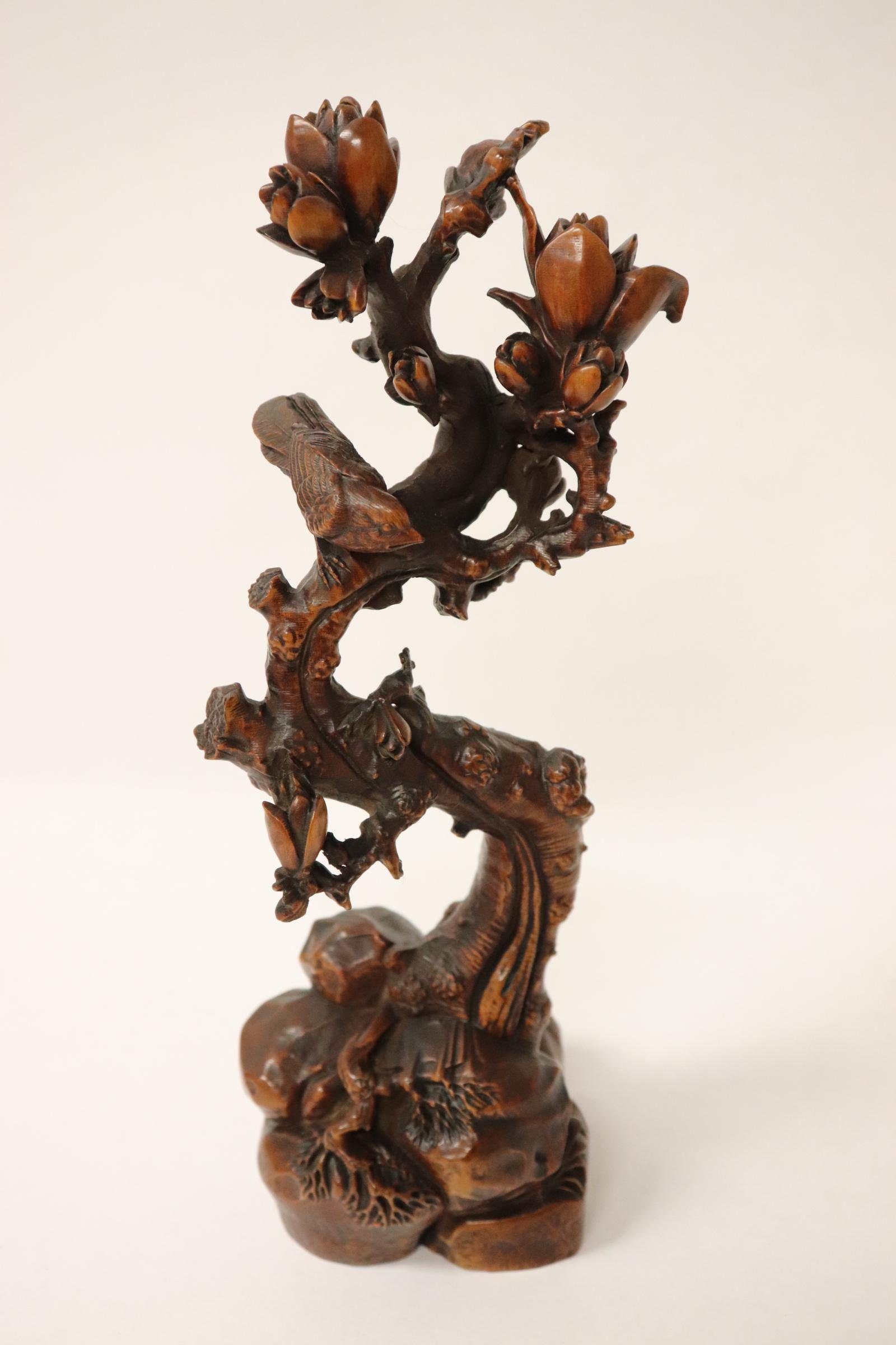 Chinese wood carving depicting bird on tree