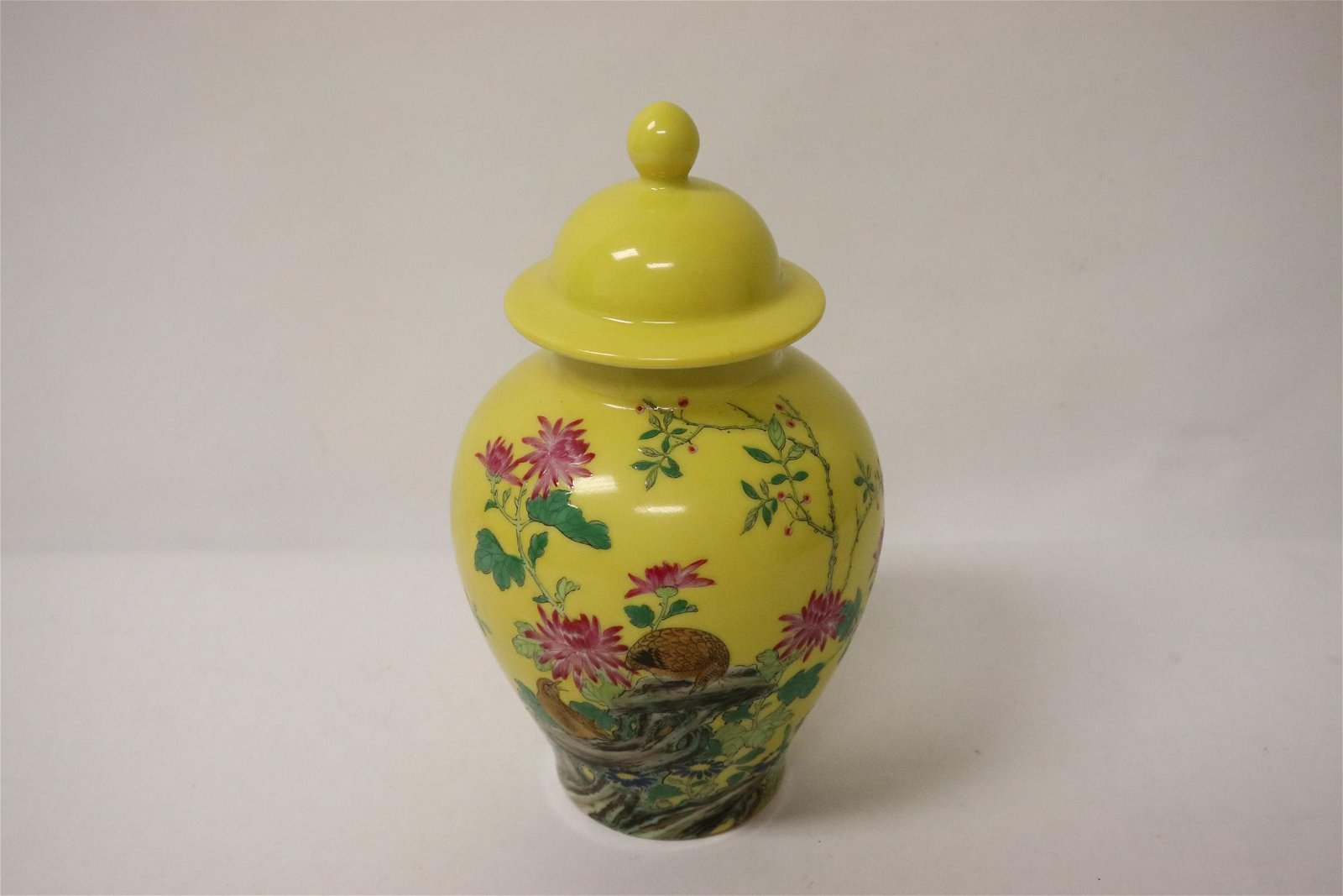 yellow background small famille rose covered jar