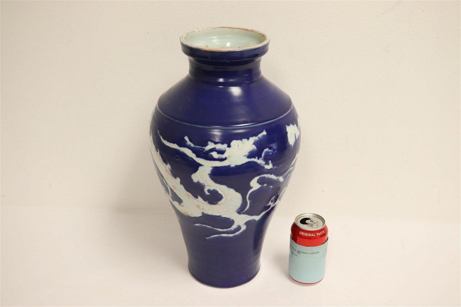 Chinese white on blue porcelain vase