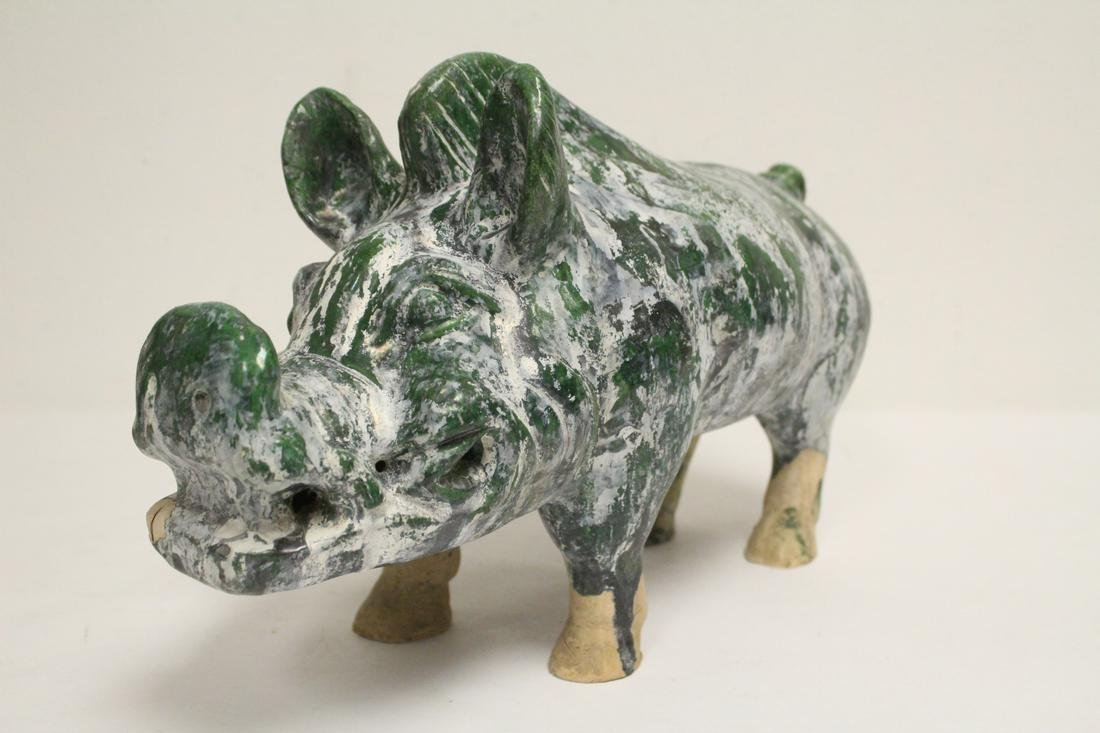 A Han style green glazed pottery pig