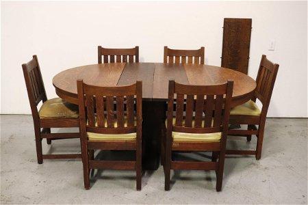 Antique oak dining room set by L & J. G. Stickley