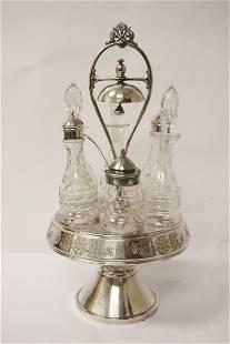 A very fancy silverplate cruet set with dinner bell