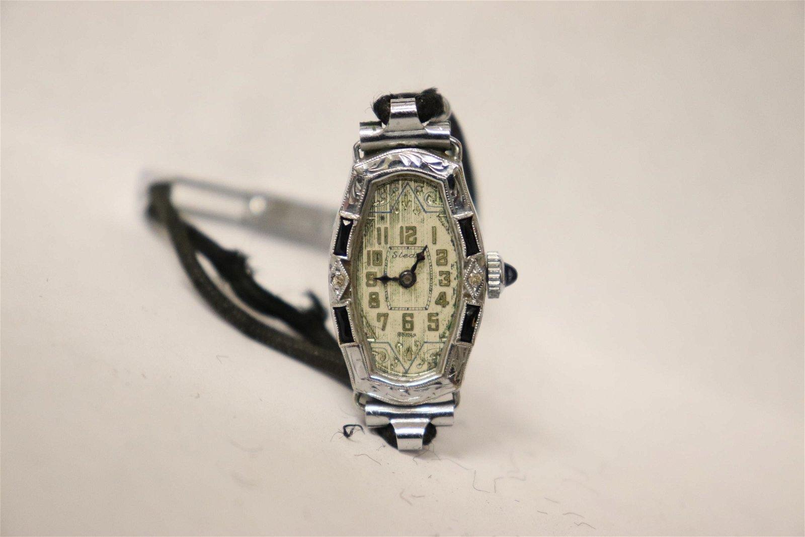 Lady 14K W/G art deco diamond wrist watch
