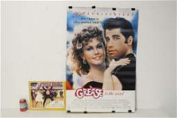 movie poster of Grease and a lobby card signed