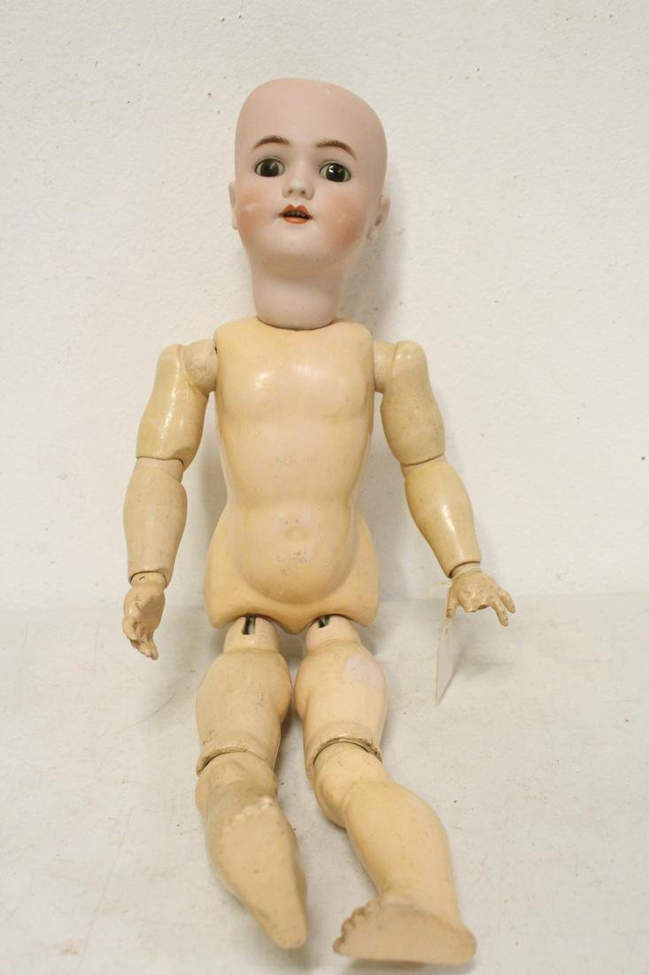 Antique bisque head doll by Simon and Halbig