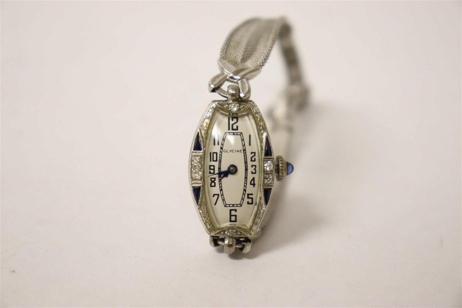 18K wrist watch by Glycine w/ diamond & blue stones