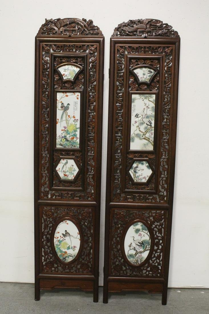 Pr Chinese rosewood framed panels w/ porcelain plaques