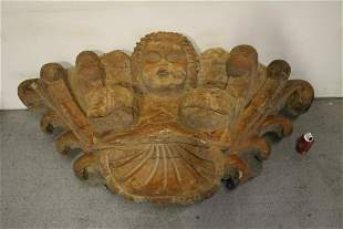 A massive wood carved wall hanging ornament