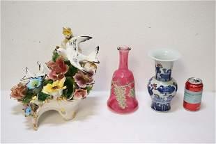Porcelain sculpture, a cranberry glass bottle & a