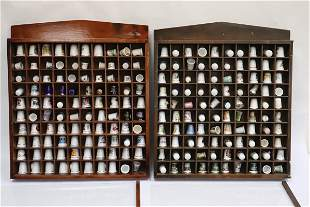 Lot of porcelain thimbles in display case