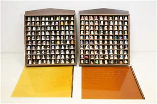Lot of porcelain and wood thimbles in display case
