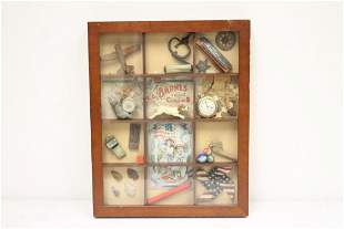 Small wall hanging display case with items
