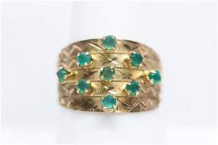 14K rose gold ring set with small emerald