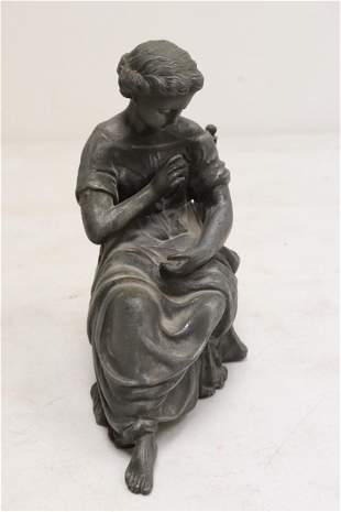 Fine spelter sculpture depicting seated lady