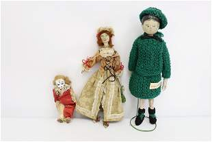 2 antique wood(?) dolls and an antique clown doll