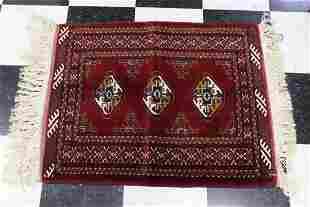 A small Persian wool hand made rug