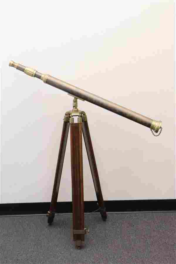 A brass telescope on stand