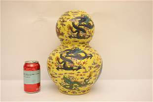 Chinese yellow background famille rose vase