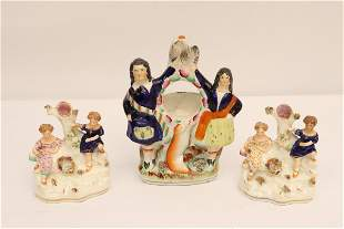 Three 18th/19th c. staffordshire candle holders