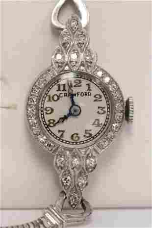 14K lady's diamond wrist watch w/ a 14K band,