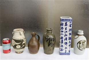 4 Chinese pottery jars/ bottles, and a b&w vase